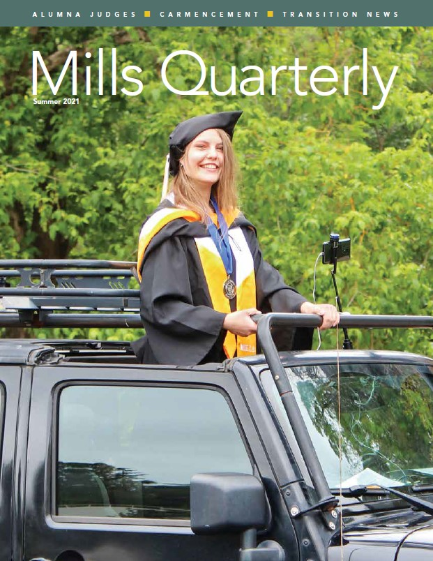 From the summer cover: A new graduate stands through the sunroof in a car at CARmencement 2021